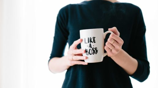 women holding like a boss coffee mug