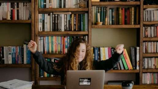 girl celebrating at her computer