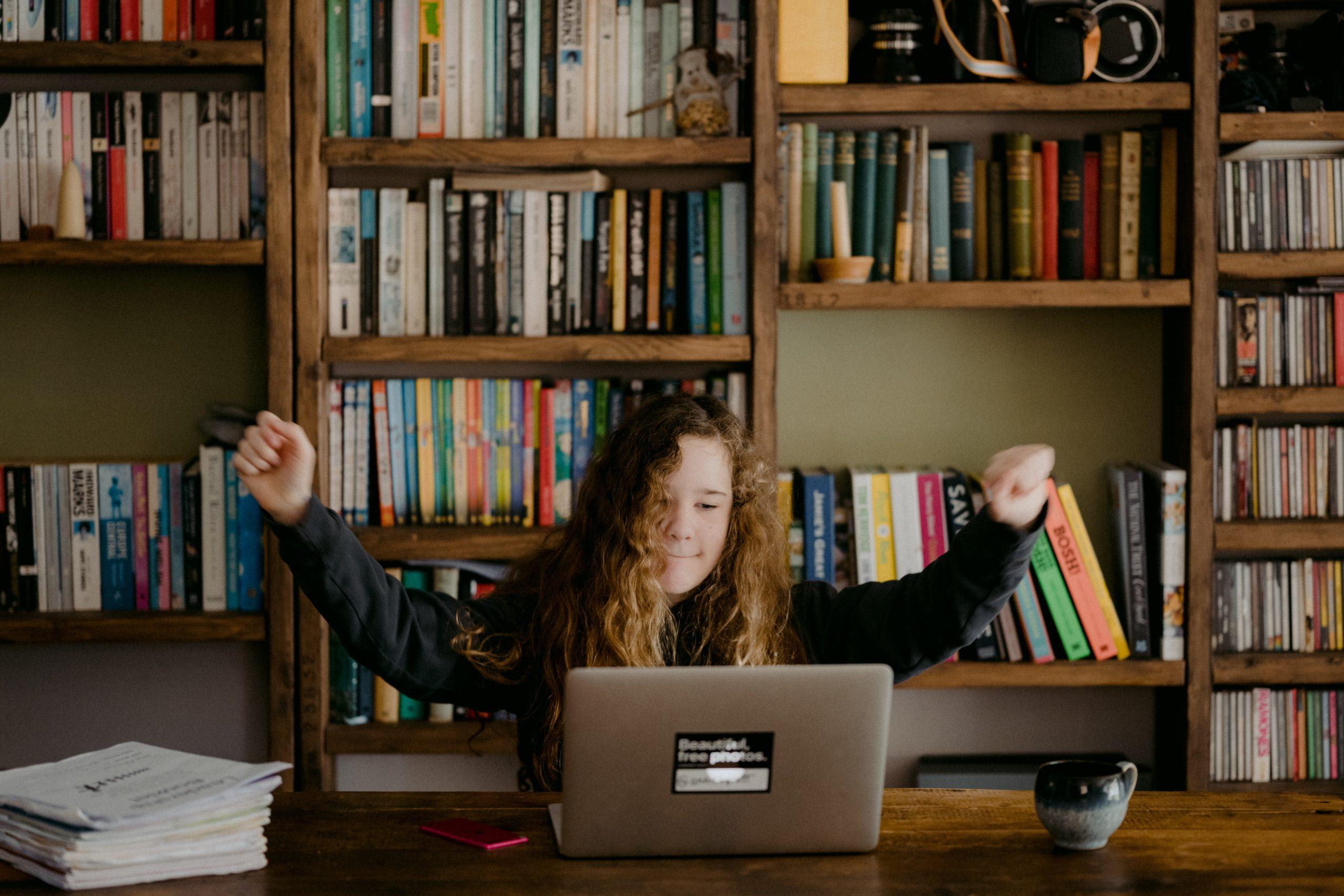 girl celebrating at her computer