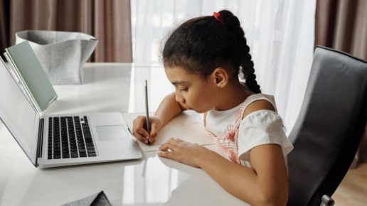girl doing classwork at the computer