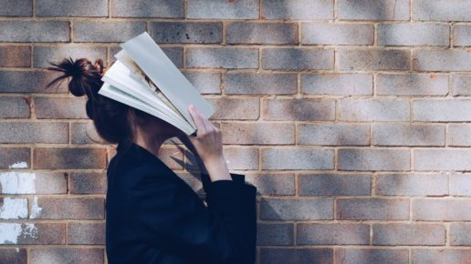 woman with a book on her face