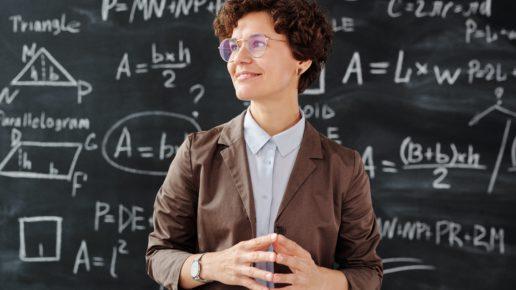 teacher in front of chalkboard