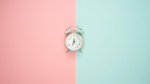 clock with pink and blue split background
