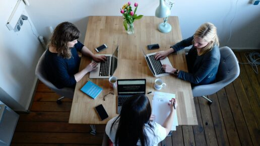 3 women working at a table