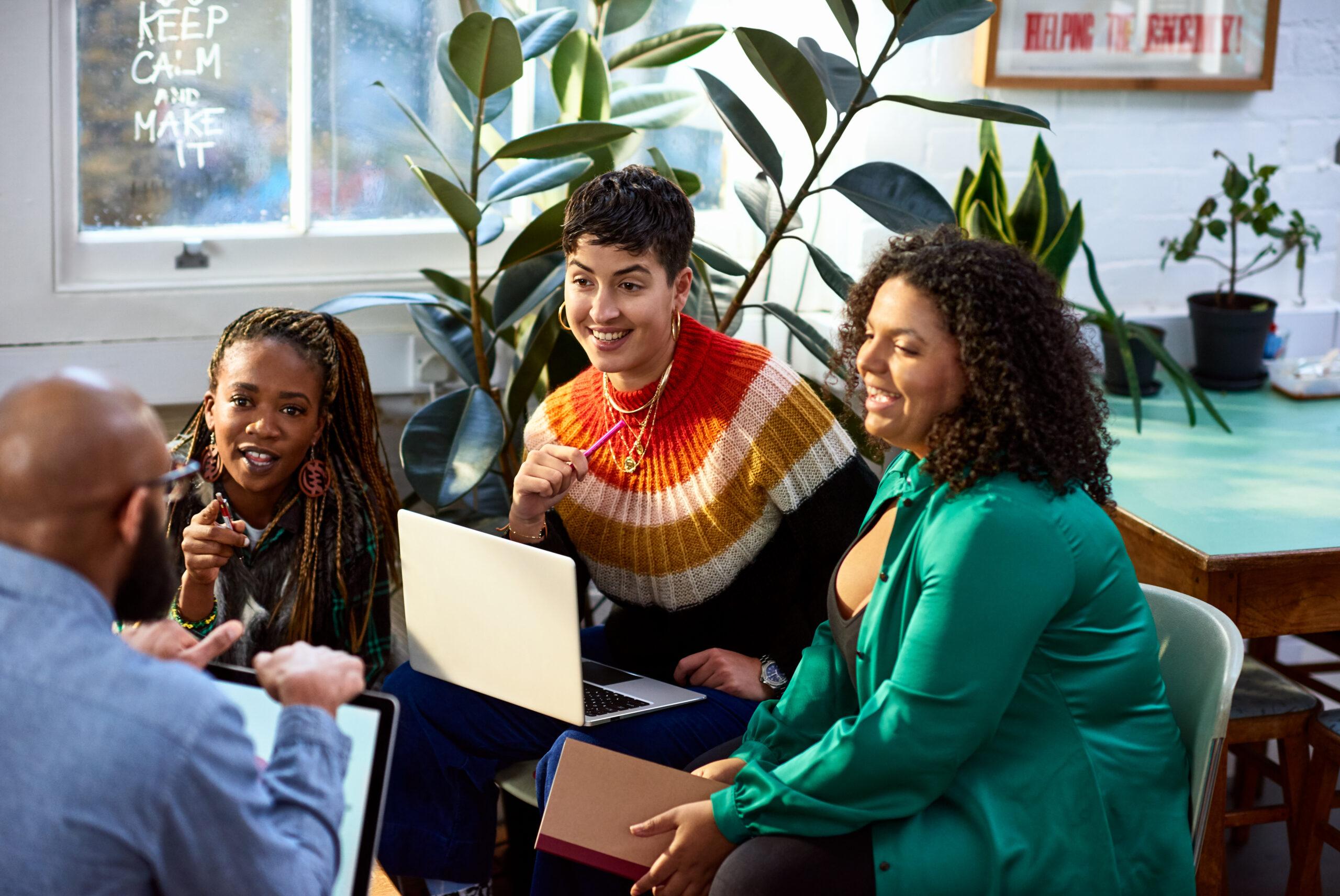 Business women talking to male colleague, informal meeting