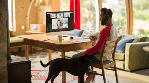 man working from home during lockdown with his dog