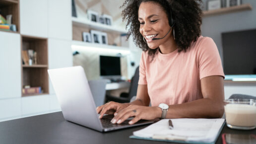 Beautiful afro-american woman using laptop at home for online video call